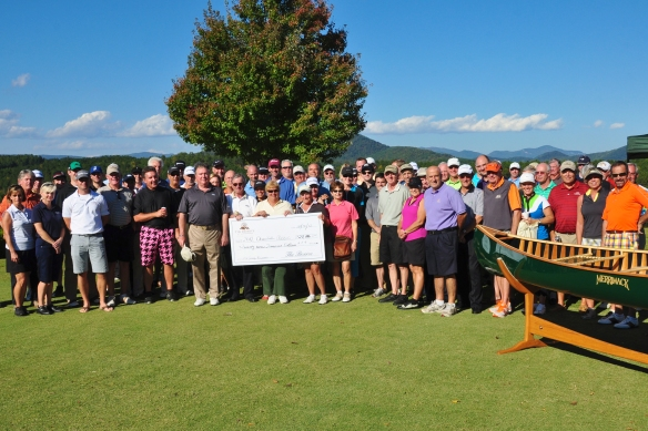 "2012 Charitable Foundation Golf Classic Participants celebrate the ""Big Check."" Save the Date: our 2013 tournament is October 22!"